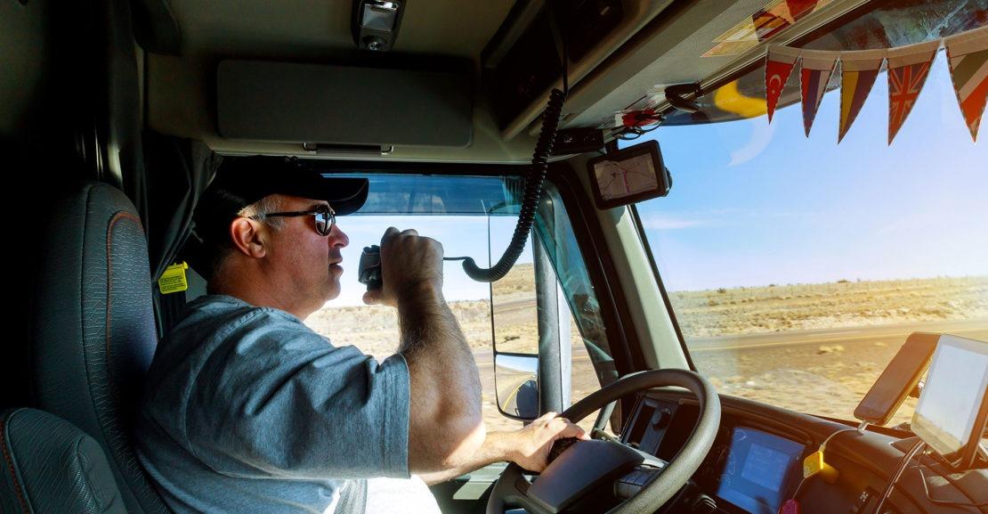 Seasoned truck drive driving while on CB radio